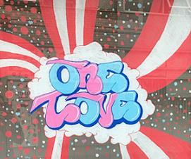 """One Love"" street art painted in the window of Stroud Town Council"