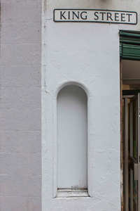 "Arched niche on the exterior of 47 King Street formerly used to house the ""railway time"" clock"